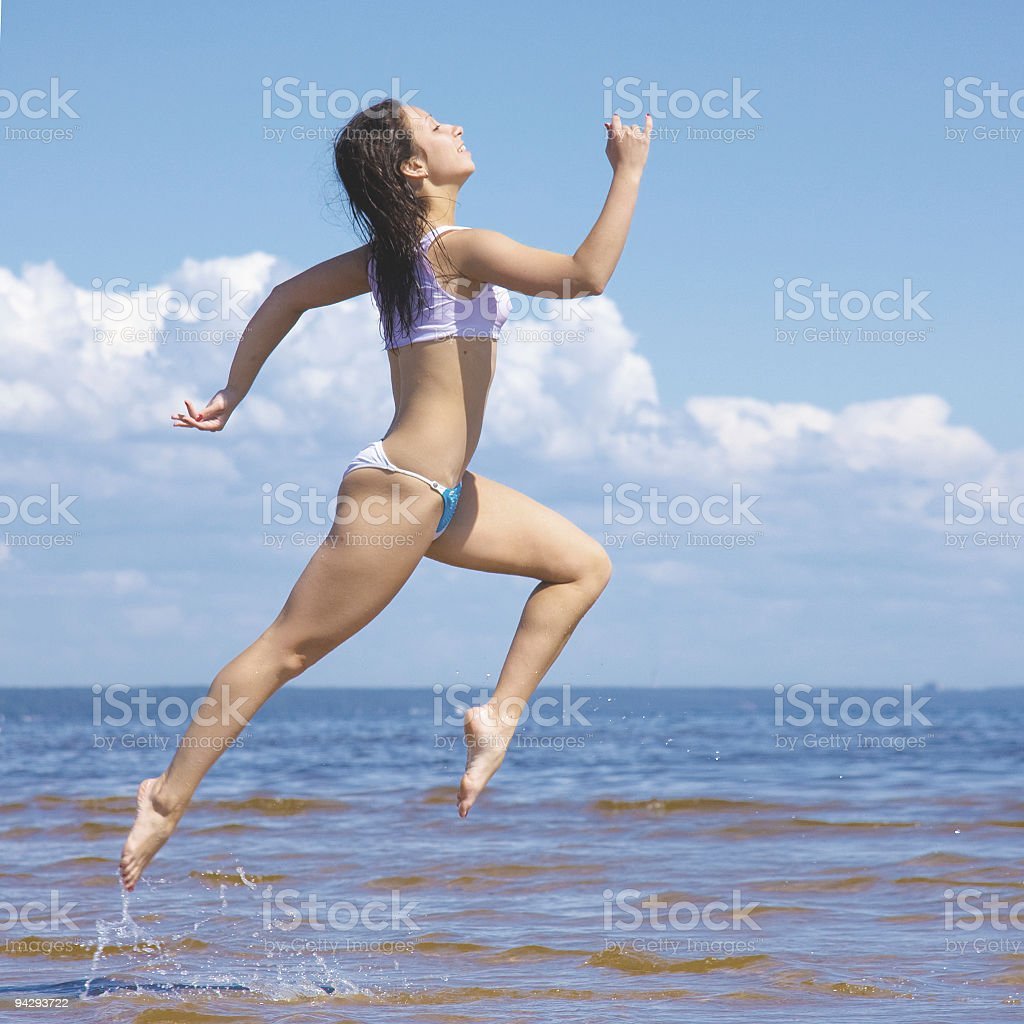 Active girl on a beach royalty-free stock photo