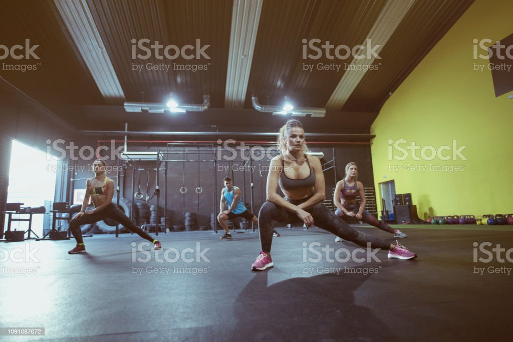 Active group of people training in sport dance class, mature woman...