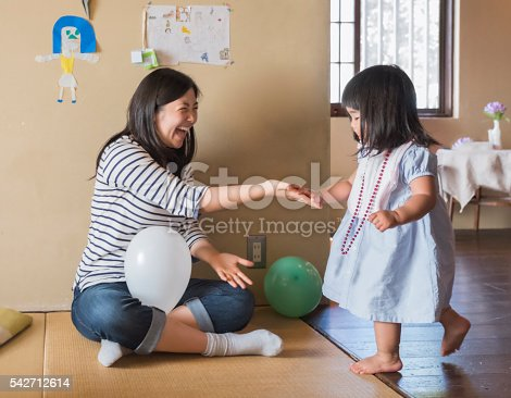 istock Active Japanese Toddler Girl Slapping Hands with Older Sister 542712614