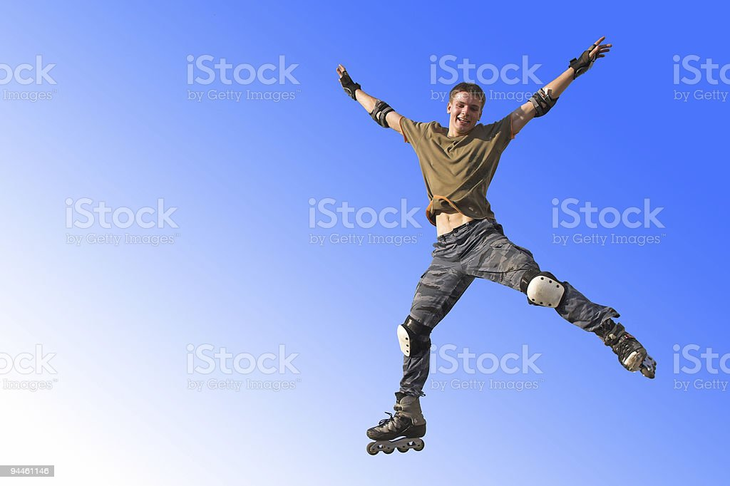 Active jumping and flying roller boy on the blue sky royalty-free stock photo