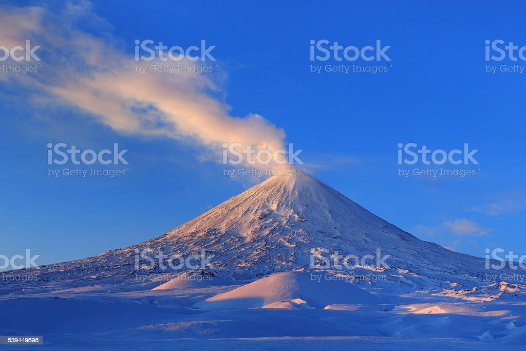 Active Klyuchevskoy Volcano at sunrise. Kamchatka Peninsula stock photo