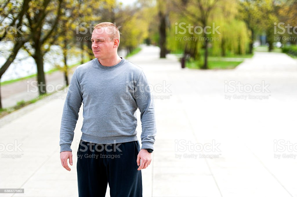 Active man with athletic body, exercise outdoor in park. stock photo