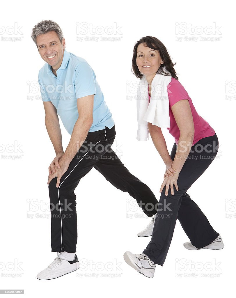 Active mature couple doing fitness royalty-free stock photo