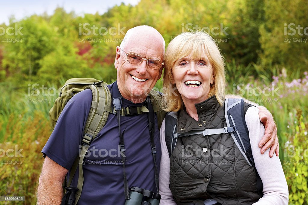 Active mature couple hiking royalty-free stock photo