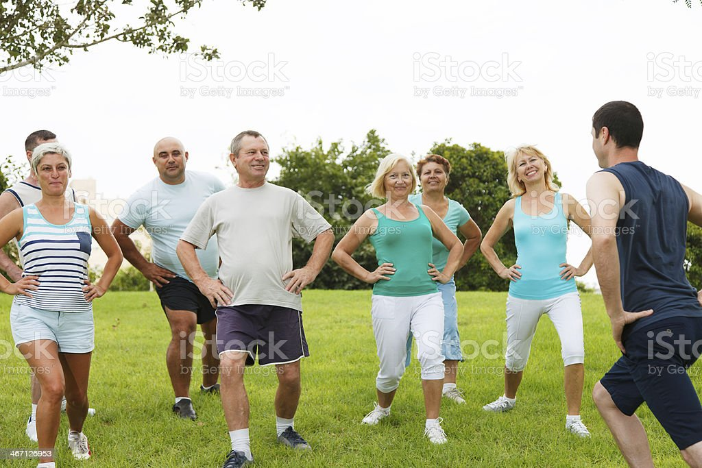 Active Mature People with fitness Trainer stock photo