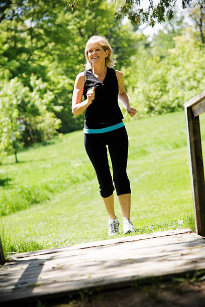 Active Mature Woman Jogging Outside stock photo
