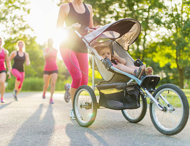 active mother jogging stock photo