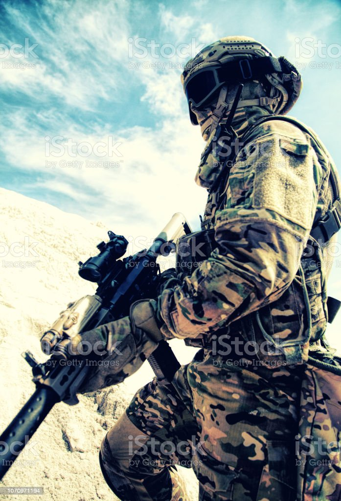 Active outdoor recreation and war games in desert stock photo