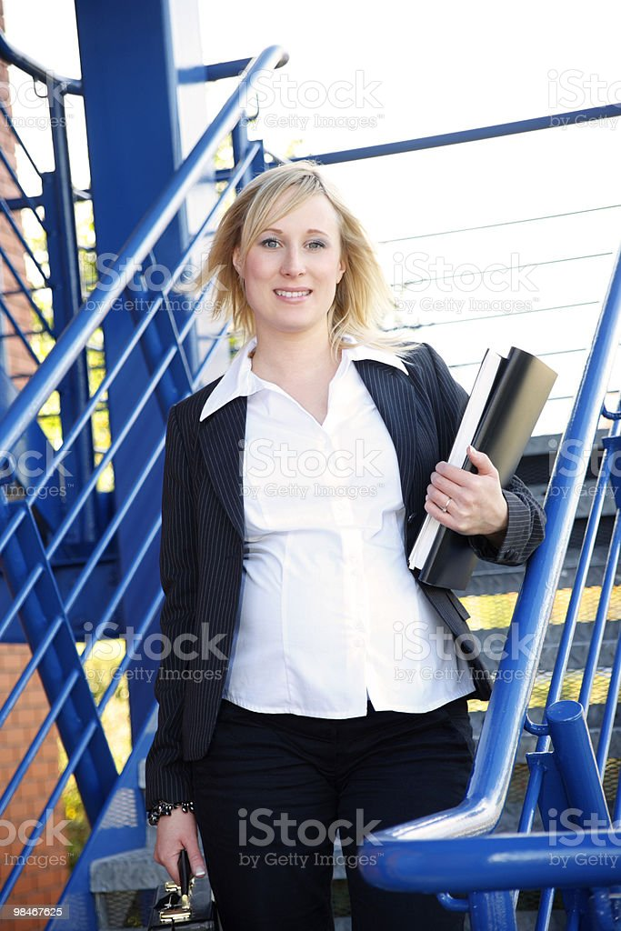 active pregnant business woman walking to her place of work royalty-free stock photo