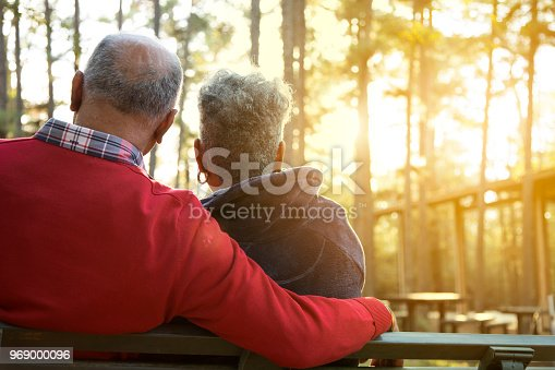 istock Active senior adult couple enjoy outdoor park at sunset. 969000096