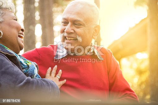 istock Active senior adult couple enjoy outdoor park. 918978426