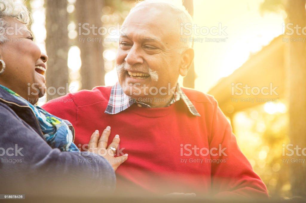 Active senior adult couple enjoy outdoor park. stock photo