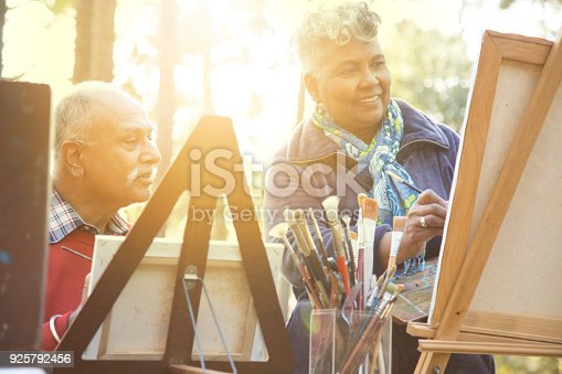 istock Active senior adult couple enjoys art hobby outdoors. 925792456