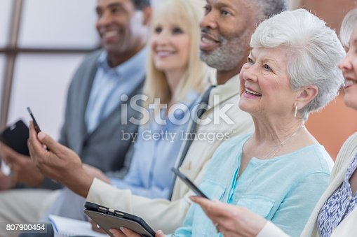 istock Active senior adults use technology during continuing education class 807900454