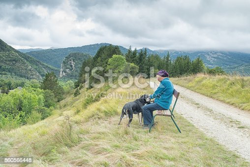 istock Active senior and dog in French mountains 860566448