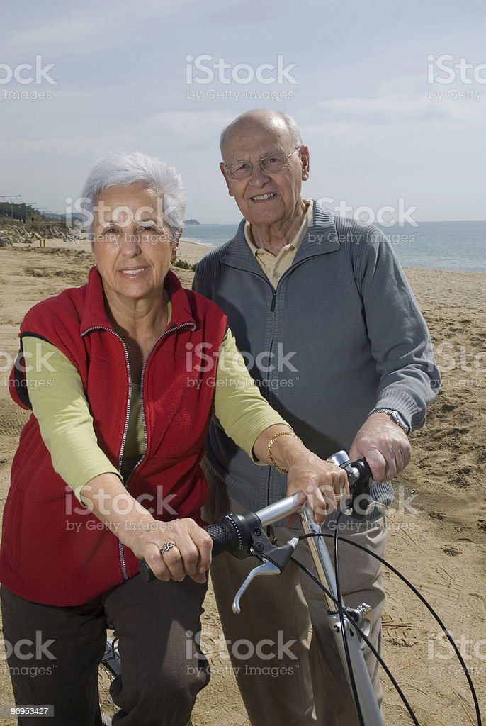 Active senior couple biking royalty-free stock photo