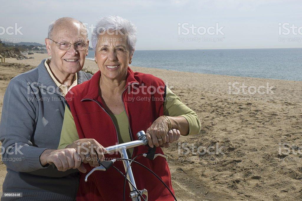 Active senior couple biking royalty-free stock photo