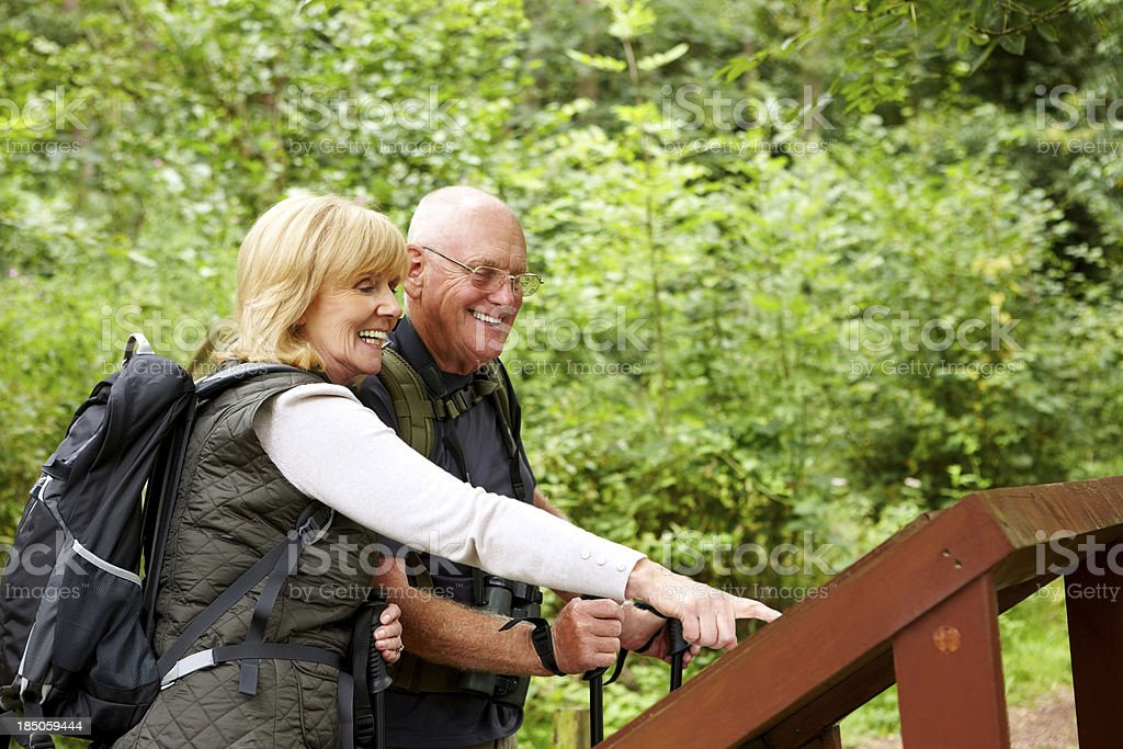 Active senior couple on a hike royalty-free stock photo