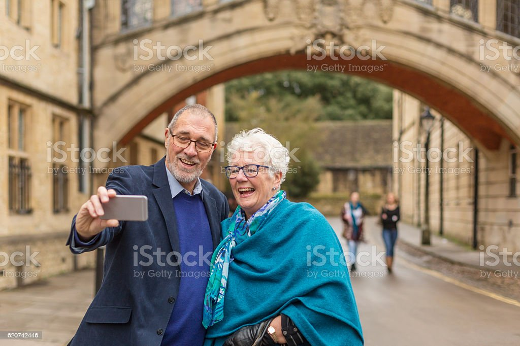 Active Senior Couple Taking Selfie at Bridge of Sighs stock photo