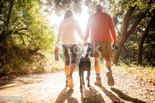 Active senior couple on a hike outdoors