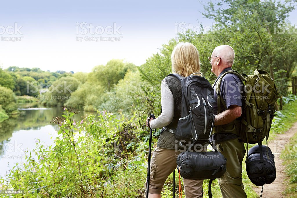 Active senior hikers looking at a view stock photo