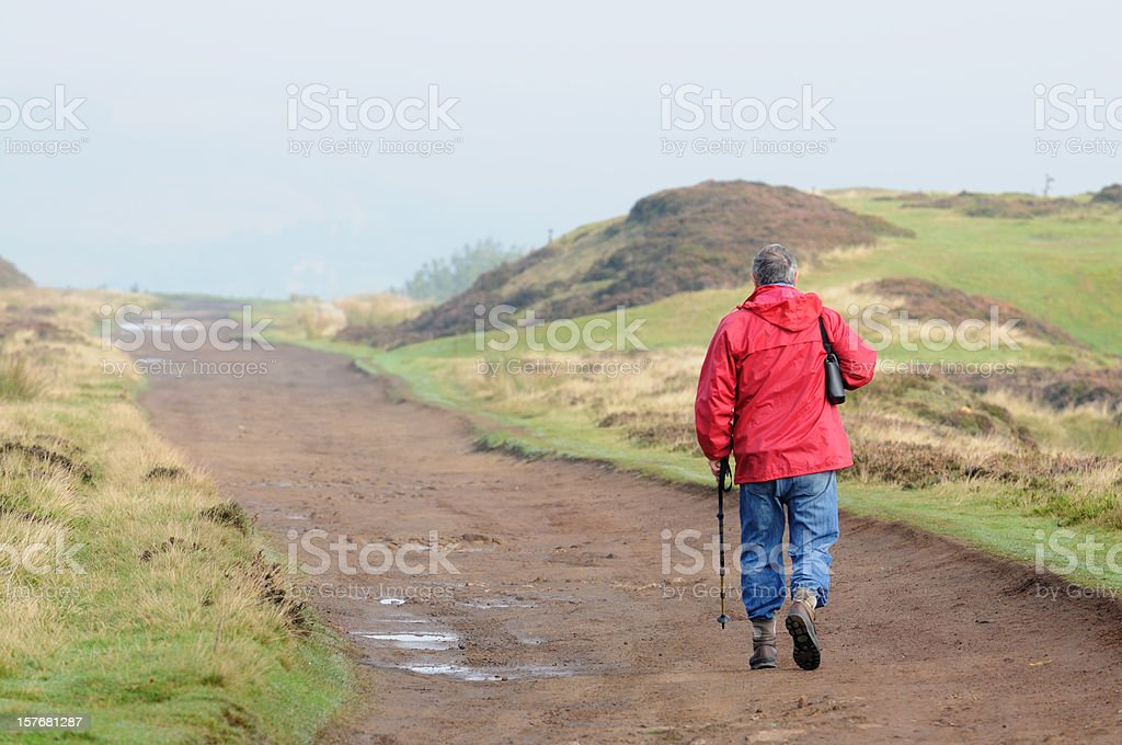 active senior hiking on the moors royalty-free stock photo