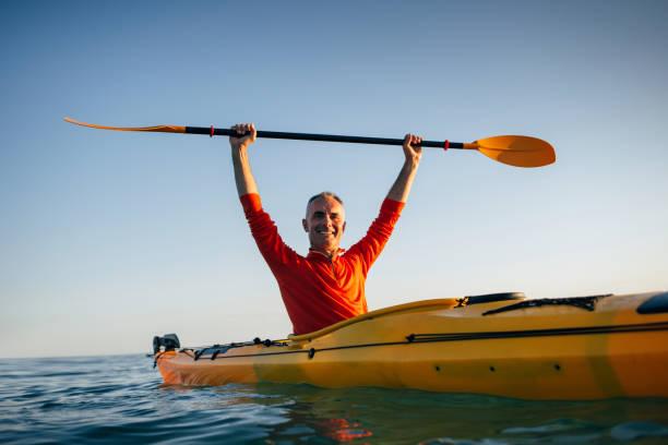 Active senior kayaker stock photo