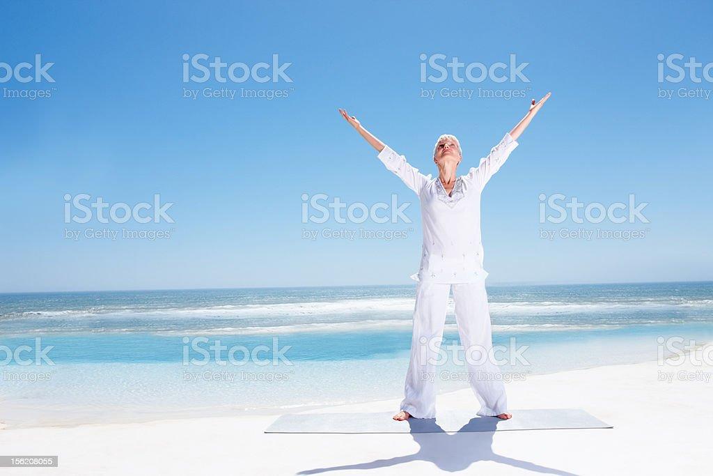 Active senior lady exercising on beach royalty-free stock photo