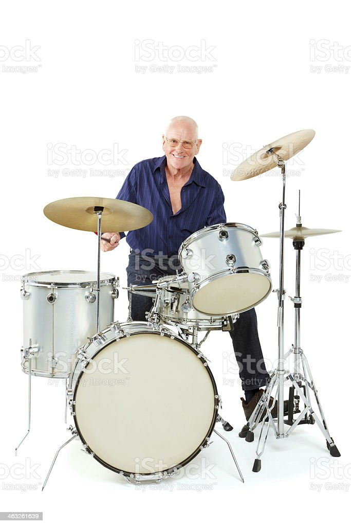 Active senior man playing drum set stock photo