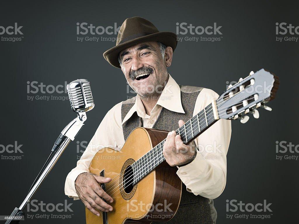 Active senior man playing guitar royalty-free stock photo