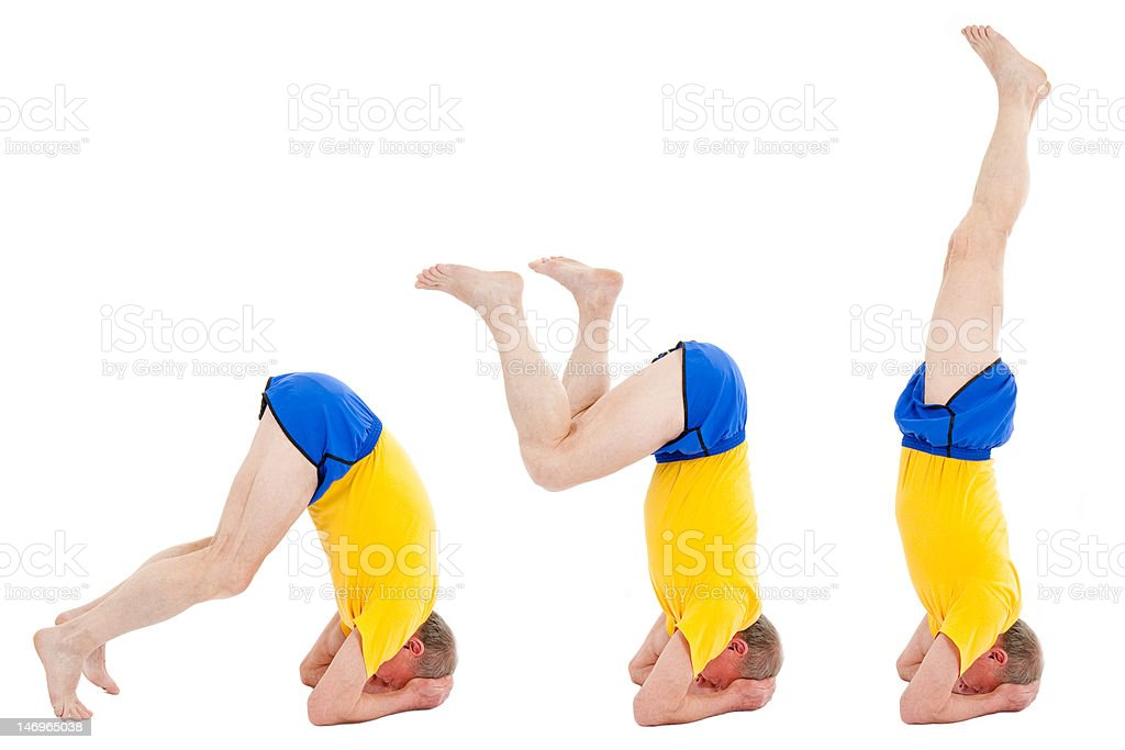 Active senior man. Stand on a head royalty-free stock photo