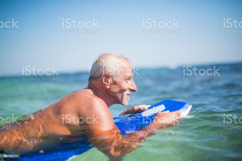 Active senior man surfing royalty-free stock photo