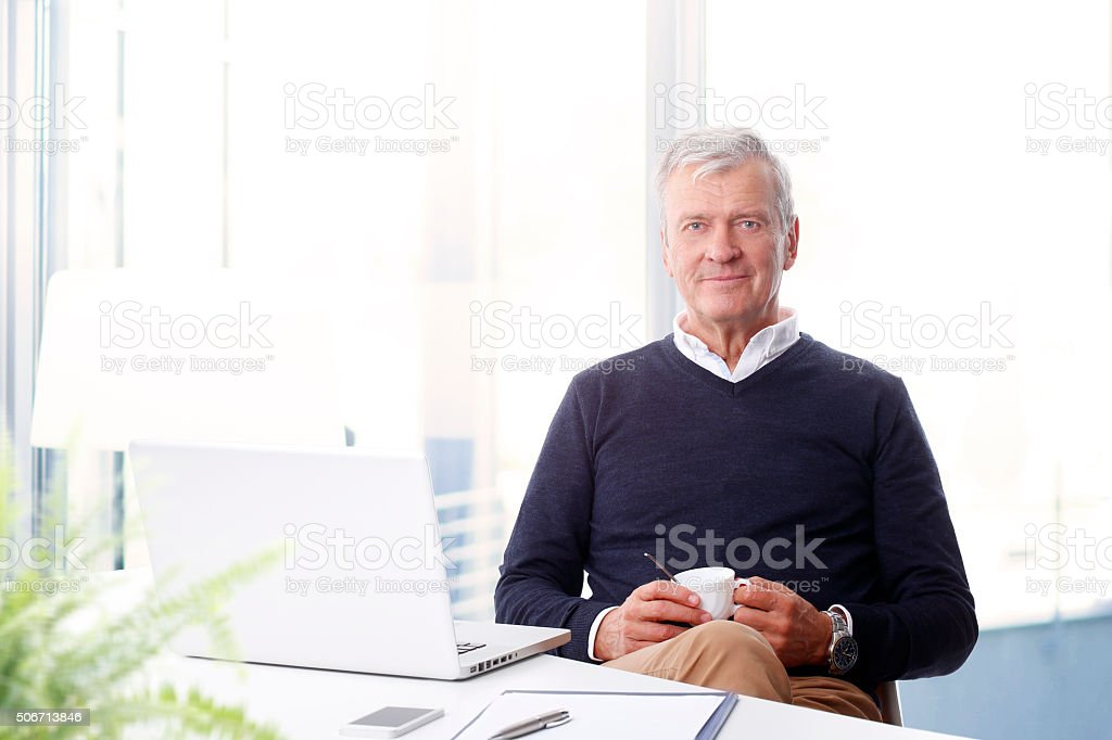 Active senior man with laptop stock photo