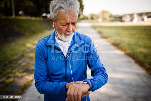 Senior Man using Smart Watch measuring heart rate