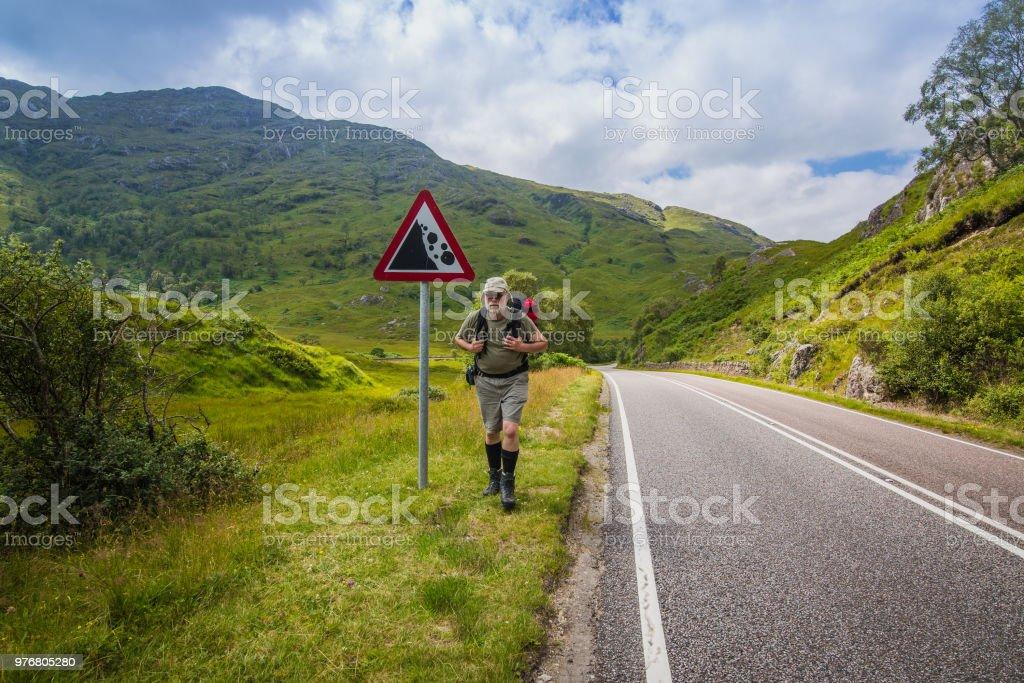 Active senior men traveling in Scotland. stock photo