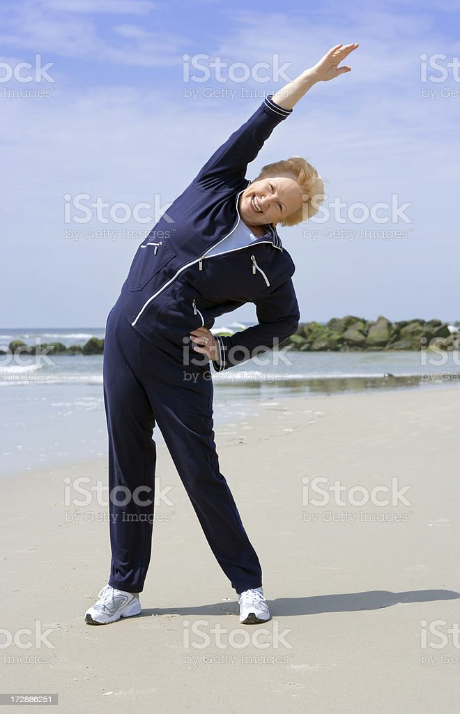Active senior stretching royalty-free stock photo