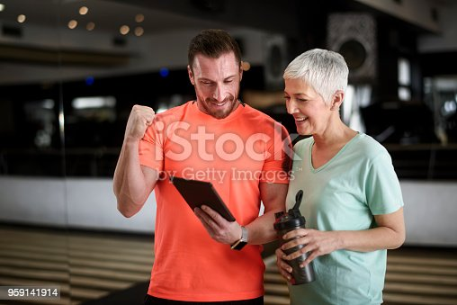 istock Active senior woman and fitness instructor 959141914