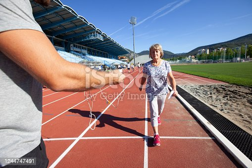 Active Senior woman at the finish line after a cardio medical exam on a Stadium