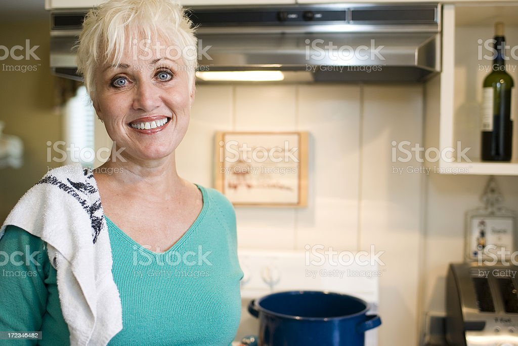 Active Senior Woman Cooking at Home in Kitchen, Copy Space royalty-free stock photo