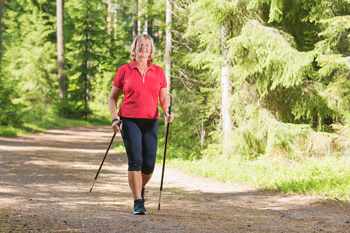 Active Senior Woman Doing Nordic Walk Exercise Stock Photo - Download Image Now