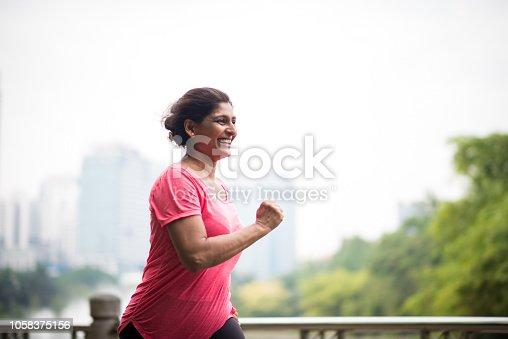 Senior woman running in a park