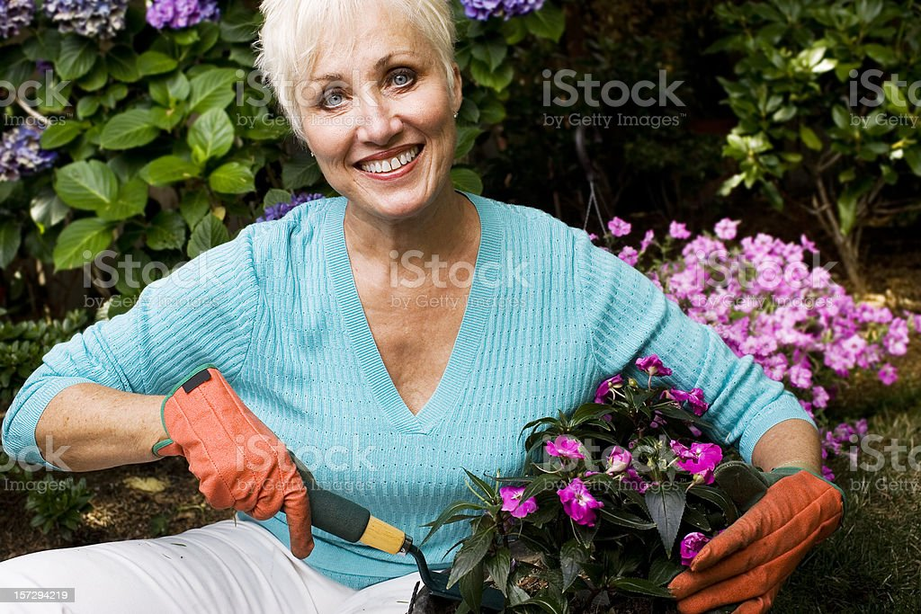 Active Senior Woman Gardening, Copy Space royalty-free stock photo