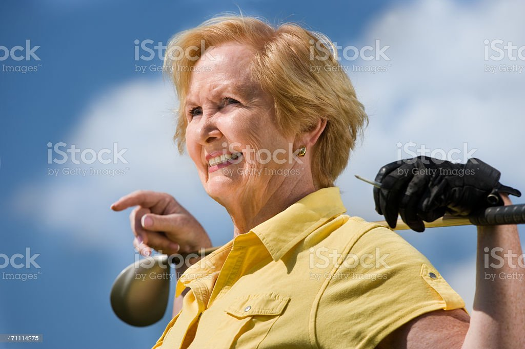 Active senior woman golfer royalty-free stock photo