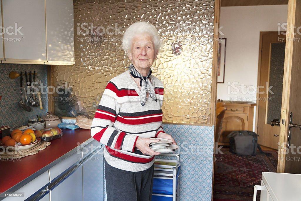 active senior woman in kitchen royalty-free stock photo