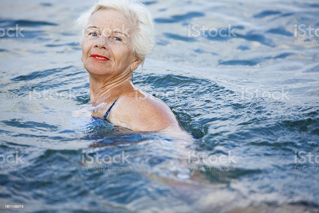 Active senior woman in swimming pool royalty-free stock photo