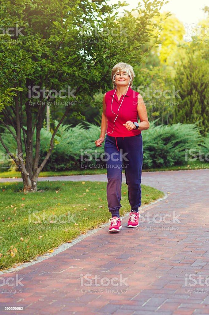 Active senior woman running royalty-free stock photo