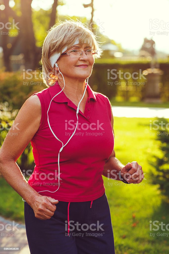 Active senior woman running royalty-free stock photo