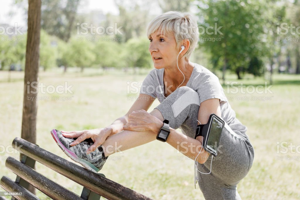 Active senior woman stretching leg royalty-free stock photo
