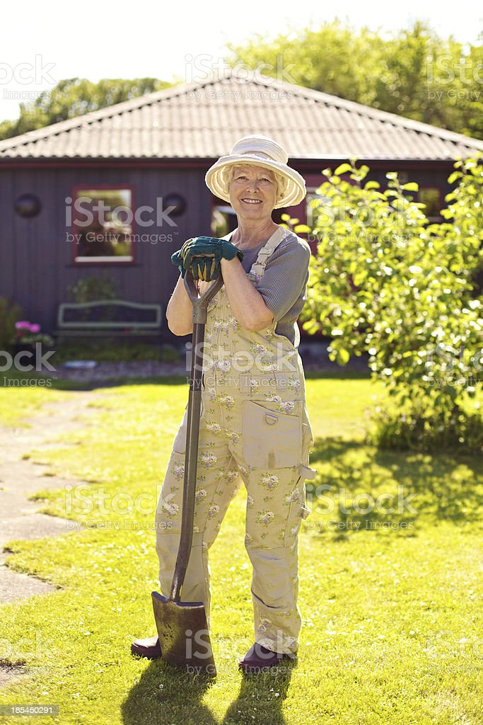 Active senior woman with gardening tools stock photo