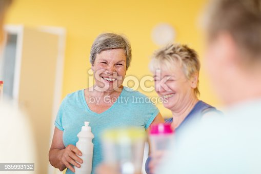 istock Active senior women chatting after yoga class, enjoying the after effects of exercising 935993132